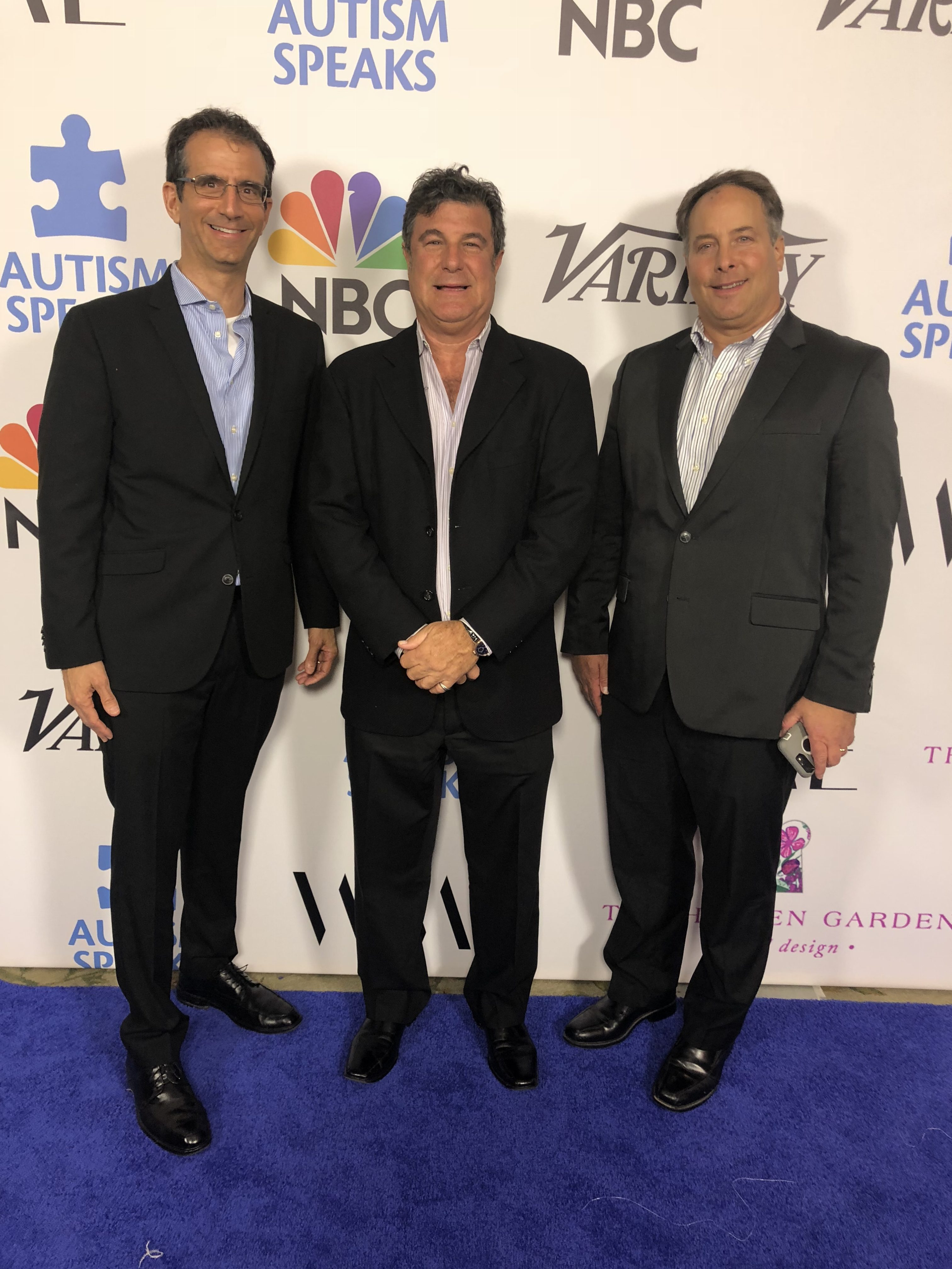 "(from left) Rodeo Realty agents Ken Marker, Corey Brown, and Ed Dolce at the 2018 Autism Speaks ""Into the Blue"" Gala-The Beverly Hills Hotel"